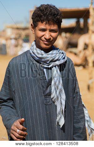 DARAW, EGYPT - FEBRUARY 6, 2016: Portrait of local boy at Camel market.