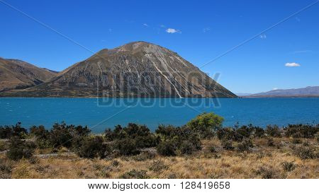 Turquoise Lake Ohau. Ben Ohau Range. Travel destination in New Zealand.