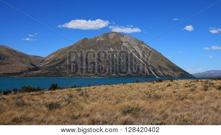 Mountain range in New Zealand. Lake Ohau.