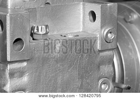 part of a casing of a reducer closeup of glossy gray color for an industrial mechanical background