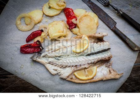 sea bass fish baked with potato and red pepper