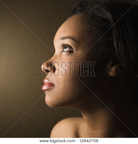 Profile of serious African-American young adult female.