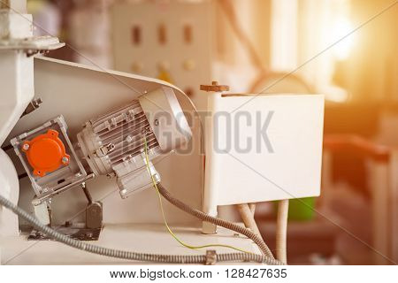 Industrial equipment and wires. Wires connected to device. Small electric motor. Fast-paced energy production.