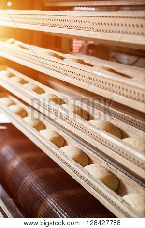 Baking of bread at the bakery. Great bakery. Production of buns. Workshop of making desserts. Bread baking in the automatically oven. ** Note: Soft Focus at 100%, best at smaller sizes