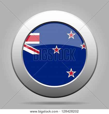 metal button with the national flag of New Zealand on a gray background