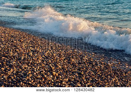 waves at pebble beach at sunset in Abkhazia