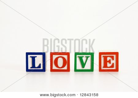Alphabet toy building blocks spelling the word love.