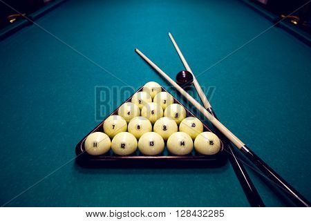 white balls for Billiards in a triangle and two cue and black ball