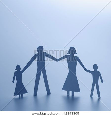 Cutout people family of four standing holding hands.