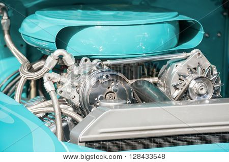 chrome and turquoise engine bay on a high performance vehicle