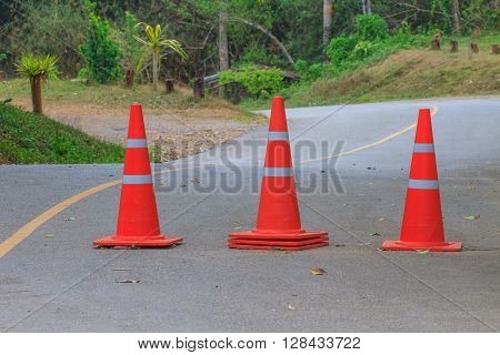 traffic warning cone on road in parking area