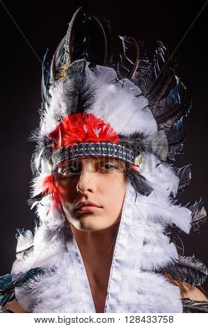 Beautiful young native American Indian woman on black background