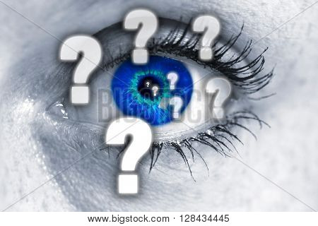 Question mark eye looks at viewer concept.
