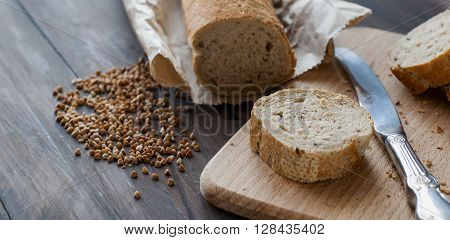 Buckwheat Bread With Buckwheat On A Wooden Table