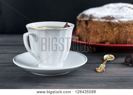 Piece Of Cake With Fruit Andcup Of Tea With Lemon