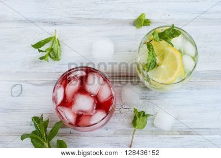Cocktail With Juice And Ice And Cocktail With Ice, Lemon And Mint