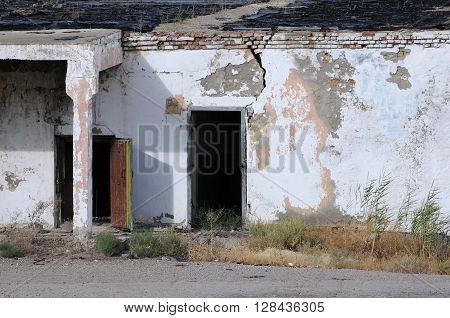 Old shabby unpainted abandoned building in Kazakhstan