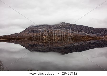 Loch Stack with the clouds and mountain reflecting in it