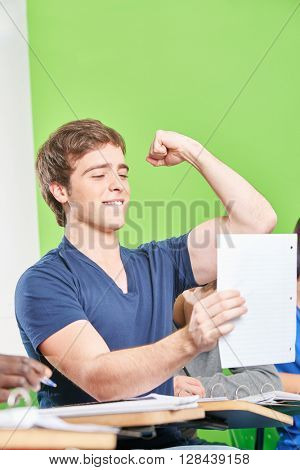 Successful student celebrates his test results in high school