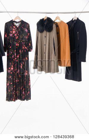Designer fashion female autumn/winter clothing on hangers