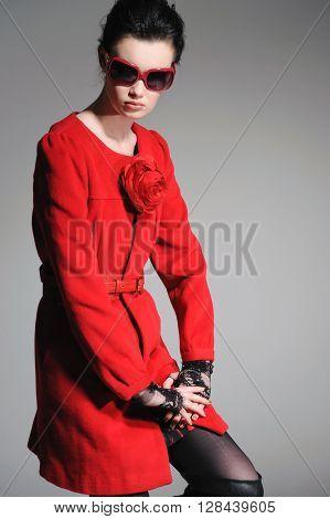 portrait of fashion model in sunglasses -gray background