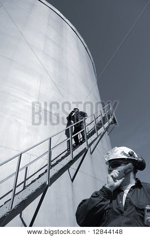oil workers and industry fuel tanks