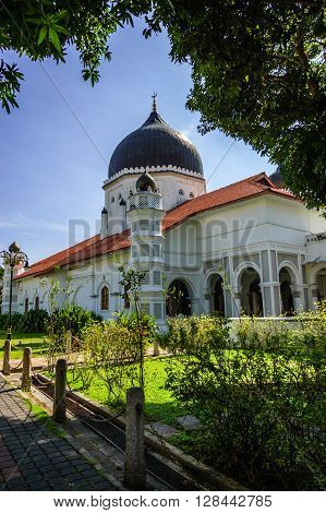 Side view of Kapitan Keling Mosque a prominent Islamic historic center built by Indian muslim traders in 19th century in historic George Town, Penang.