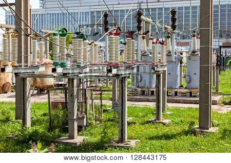 Part of high-voltage substation with switches in summer sunny day