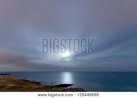 A shot of the moonrise in the coast of Arinaga