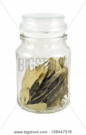 bay leaves in a glass jar with white background