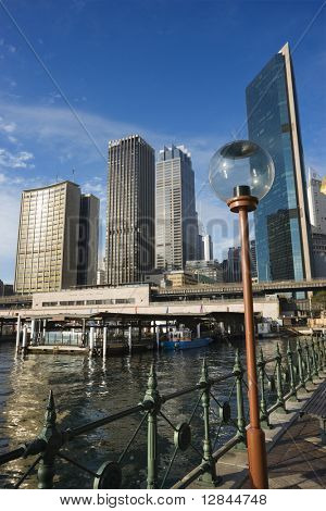 Circular Quay Railway Station in Sydney Cove with view of downtown skyscrapers and lammpost in Sydney, Australia.