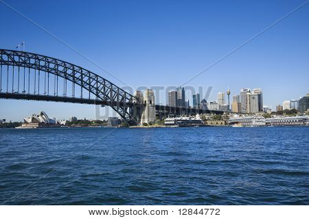 Sydney Harbour Bridge with view of downtown skyline and Sydney Opera House in Australia.