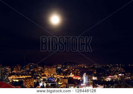 Sochi, Russia - April 23: Sochi night view of the home station with a big bright moon in the sky on April 23, 2016