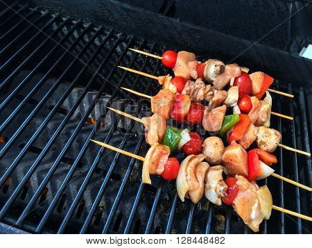 Meat and vegetable skewers ready to barbecue. Outdoor grill.