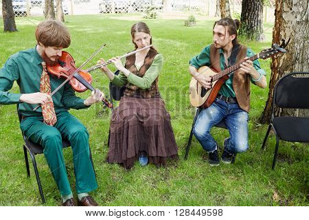 MOSCOW, RUSSIA - MAY 30, 2015: Musical Band Polca an Ri plays music in forest on summer day.