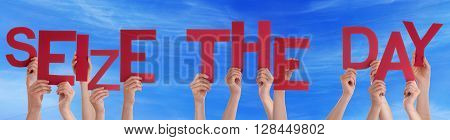 Many Caucasian People And Hands Holding Red Letters Or Characters Building The English Word Seize The Day On Blue Sky