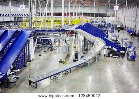 RUSSIA, MOSCOW - DEC 16, 2014: Workers in the automated sorting center at Vnukovo. Moscow Automated sorting center - the largest in Eastern Europe.