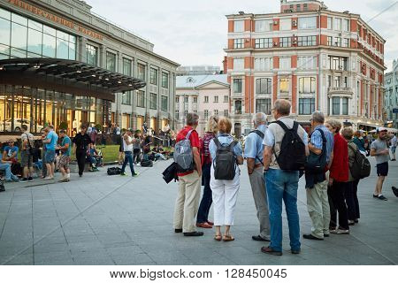 RUSSIA, MOSCOW - JUN 22, 2015: People walk along Kuznetsky Most street near TsUM Central Universal Department Store. The building was erected in 1908 by design of Roman Klein.