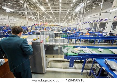 RUSSIA, MOSCOW - DEC 16, 2014: Workers of automated sorting center in Vnukovo. Moscow Automated sorting center - the largest in Eastern Europe.