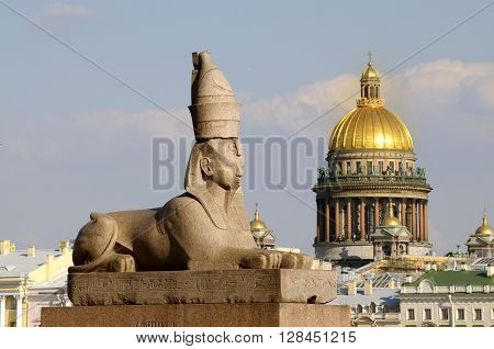 Russia. Saint-Petersburg. Granite Sphinx in the background Isaakievskogo Cathedral.