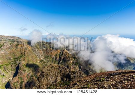 Pico do Arieiro, at 1, 818m high, is Madeira island's third highest peak. Most days, visitors can stand and look down on the clouds.