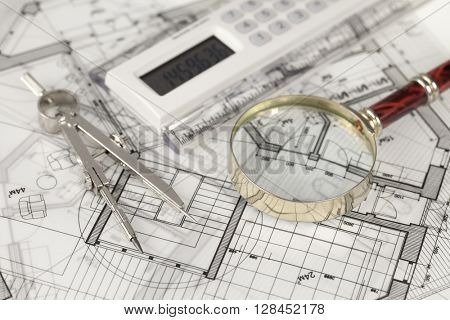 architecture blueprints -  house plans,  compass, electronic calculator & magnifying glass