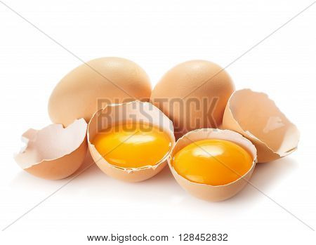 Broken chicken eggs Egg Yolks and shell closeup isolated on white background