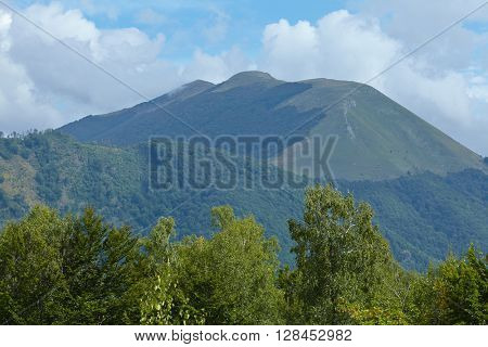 landscape with green wooded mountains