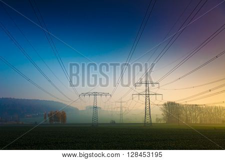 Power electric line in foggy morning