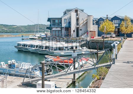 KNYSNA SOUTH AFRICA - MARCH 3 2016: The Harbor Town on the historic Thesens Island. Several types of boats including houseboats are visible