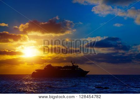 Cruise ocean liner at sunset