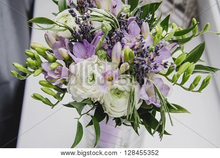 Luxure beautiful bouquet of buttercup ranunculus fresia lavender flowers on white background. Wedding style concept. Still life rustic. Soft macro.