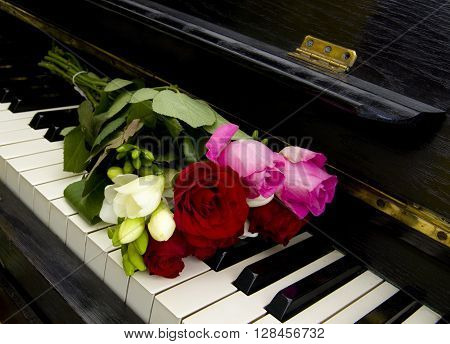Roses and other flowers on piano - condolence card