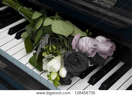 Gray Roses and other flowers on piano - condolence card